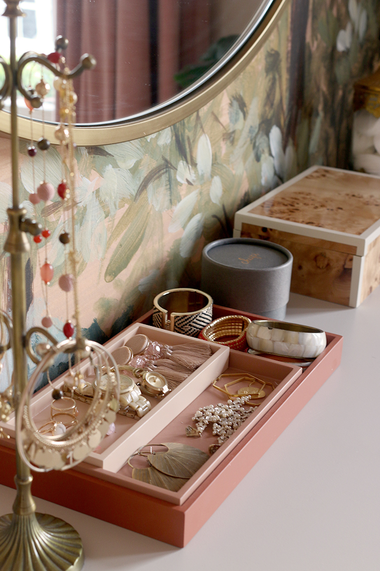 detail of jewellery in boxes on top of dressing table