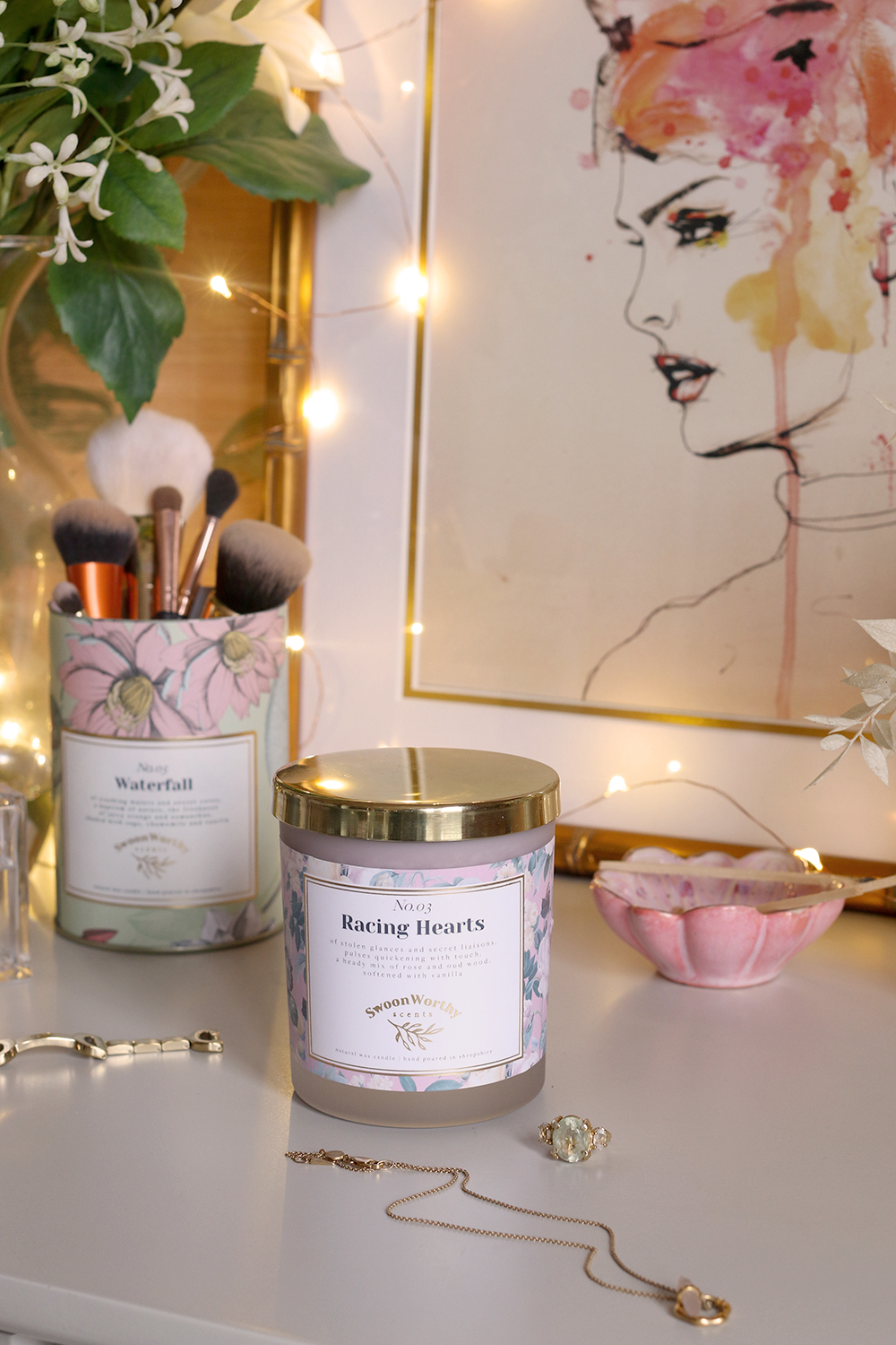 Swoon Worthy Scents gold candle lid on Racing Hearts luxury candle
