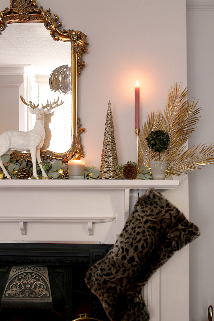 Christmas mantle detail with leopard print stocking
