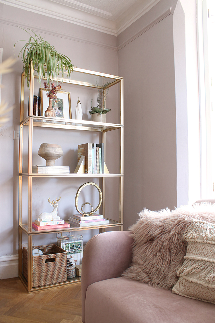 vintage gold shelving unit styled with simple christmas decor