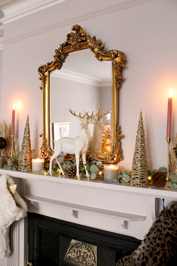 festive mantle decor for Christmas with candles and greenery