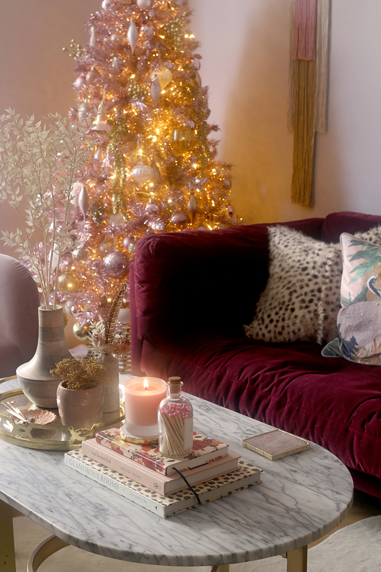 Christmas living room with pink tree and styled coffee table with dried flowers