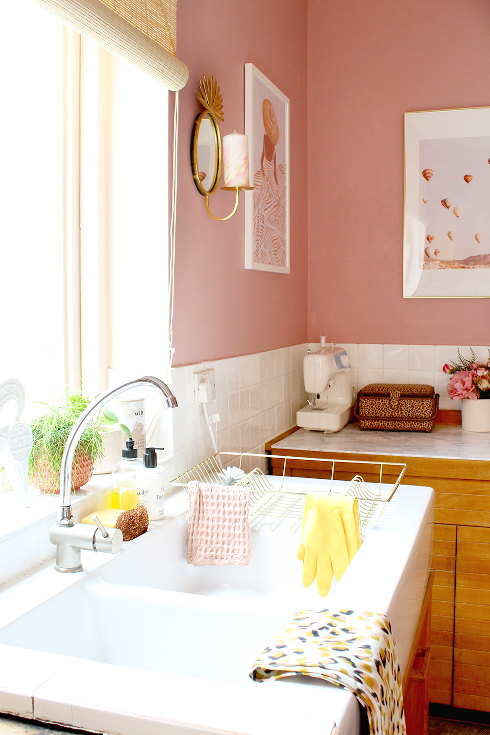 pink utility room sink with sewing corner