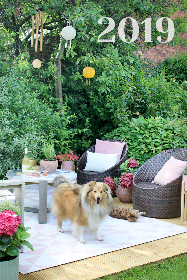 Back Patio 2019 - pink and peach decking with dog and cat