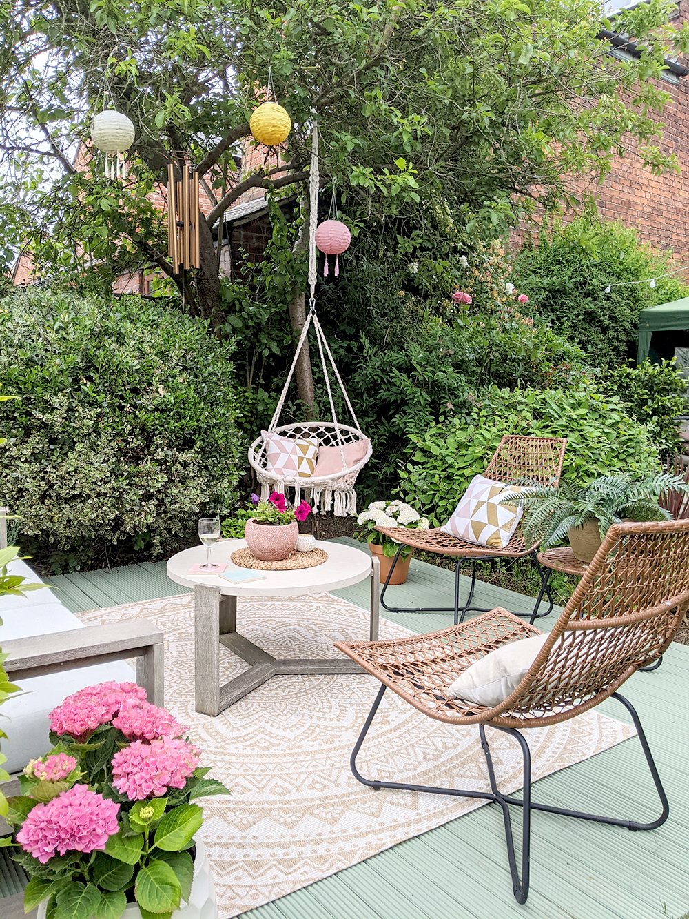 Cuprinol Willow deck with hanging chair and boho accents