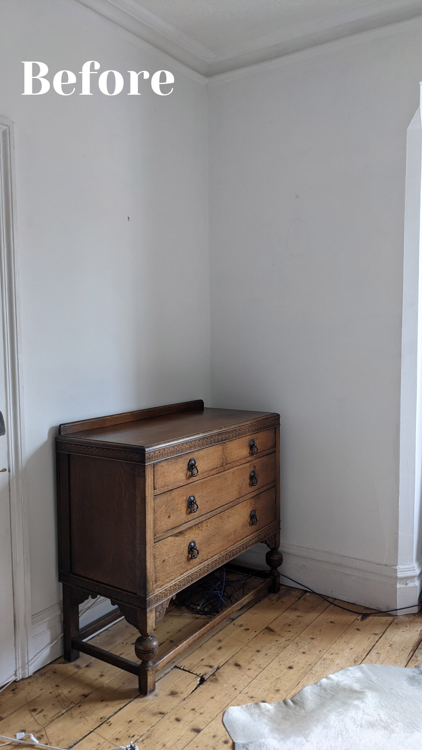 Bedroom Corner Before showing white walls with vintage chest of drawers