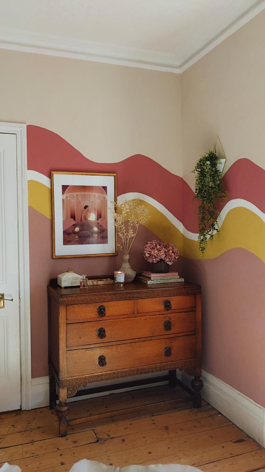 Colour block wall with organic waves in bedroom