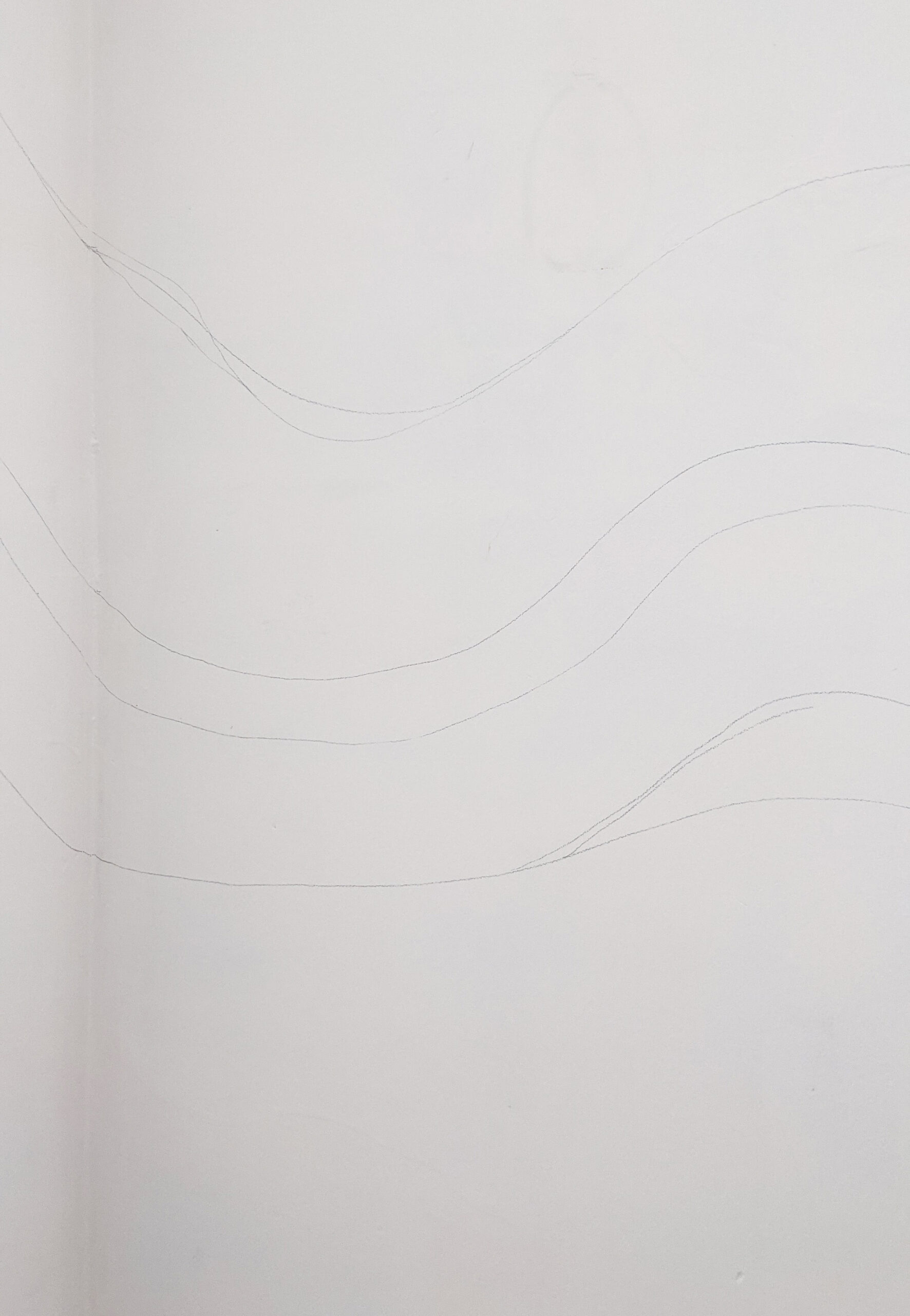 Pencil lines on white wall showing where colour block will go