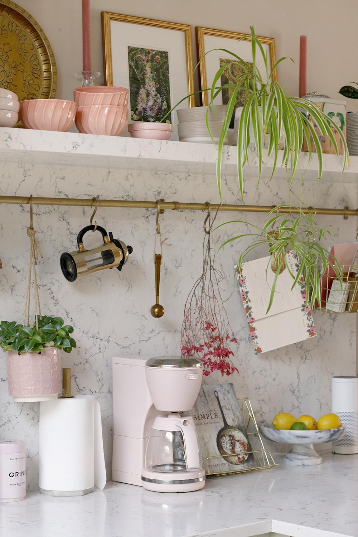 styled kitchen worktops with open shelf